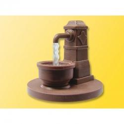 N ozdobná kašna s tekoucí vodou